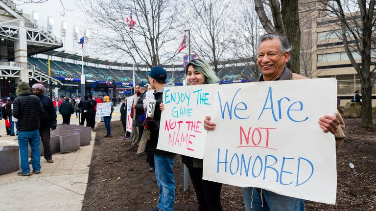 Protestors express their disapproval of the Cleveland Indians Chief Wahoo