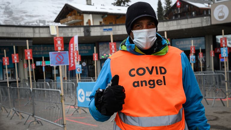 A COVID 'angel' who reminds skiers of the coronavirus safety guidance