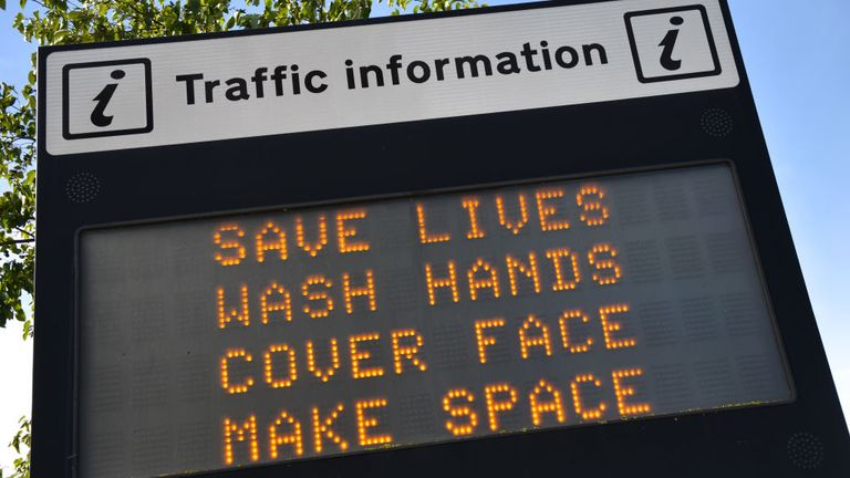 "SOUTHEND ON SEA, ENGLAND - OCTOBER 15: An illuminated travel information sign shows a public health safety notice regarding the Coronavirus pandemic saying ""Save Lives, Wash Hands, Cover Face and Make Space"" on October 15, 2020 in Southend-on-Sea, England. (Photo by John Keeble/Getty Images)"