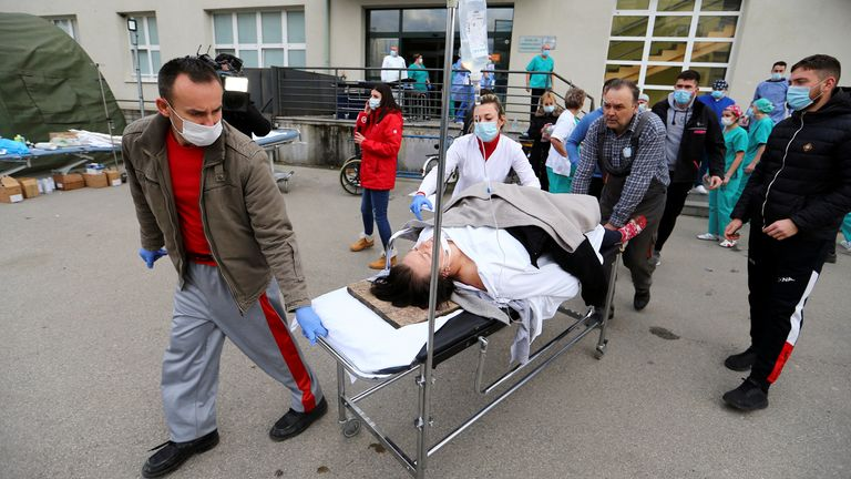 A patient is evacuated outside a hospital after an earthquake, in Sisak, Croatia December 29, 2020. REUTERS/Antonio Bronic