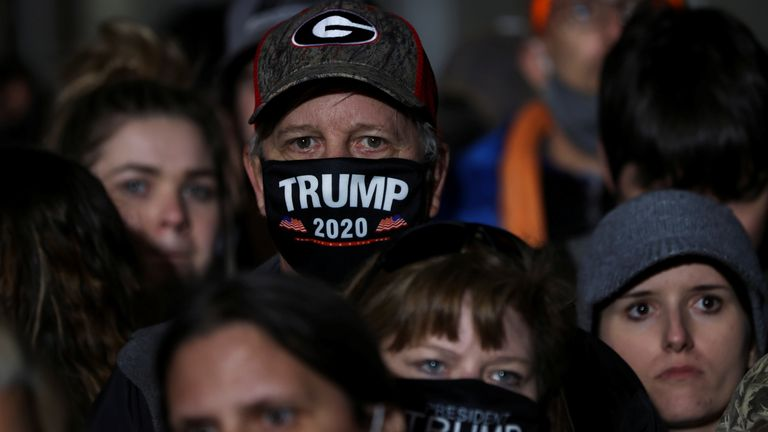 A man wearing a Trump 2020 face mask at a rally in Valdosta, Georgia