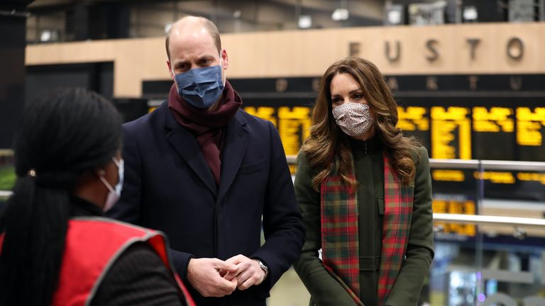 The Duke and Duchess of Cambridge speak to transport workers at London Euston Station ahead of boarding the royal train as they leave London for a tour across the UK.