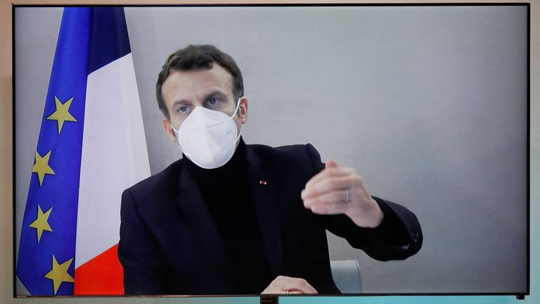 French President Emmanuel Macron, tested positive for the coronavirus disease (COVID-19), is seen on a screen as he attends by video conference a round table for the National Humanitarian Conference (NHC) at the Foreign Affairs Ministry in Paris, France, December 17, 2020. REUTERS/Charles Platiau/Pool