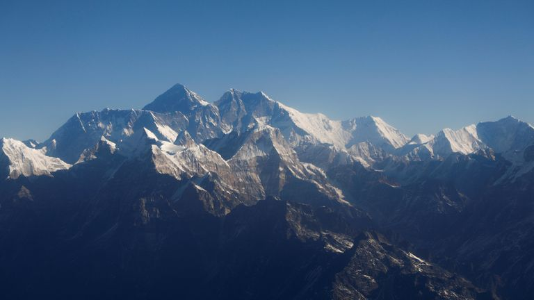 FILE PHOTO: Mount Everest, the world highest peak, and other peaks of the Himalayan range are seen through an aircraft window during a mountain flight from Kathmandu, Nepal January 15, 2020. REUTERS/Monika Deupala/File Photo