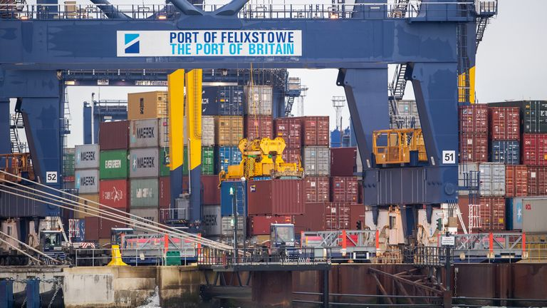 Shipping containers are unloaded from a cargo ship at the Port of Felixstowe