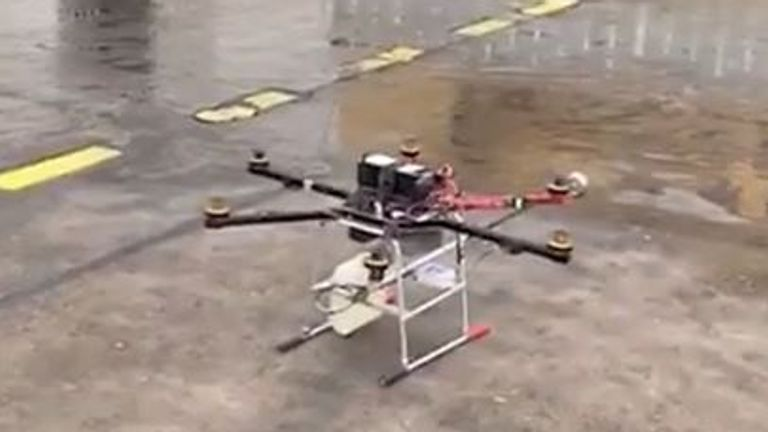 Drone loaded with a flamethrower prepares to take flight