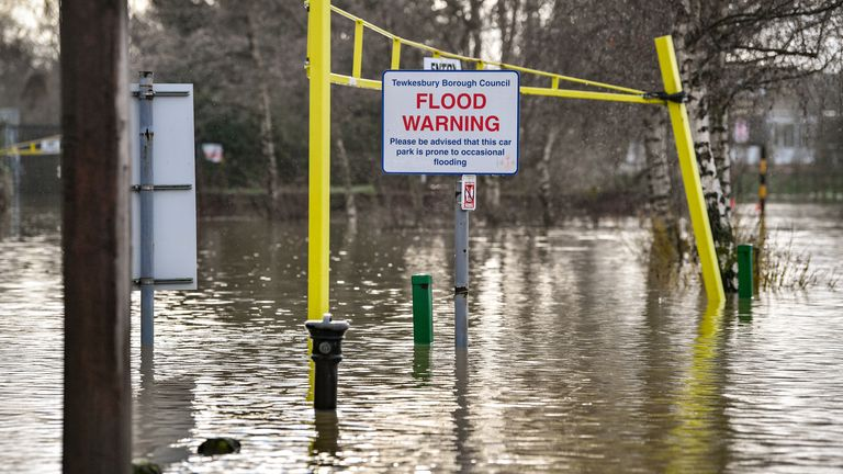 A flood warning sign at the entrance to a flooded car park beside Tewkesbury Abbey, where flood watches are in place with more wet weather expected in the coming days.