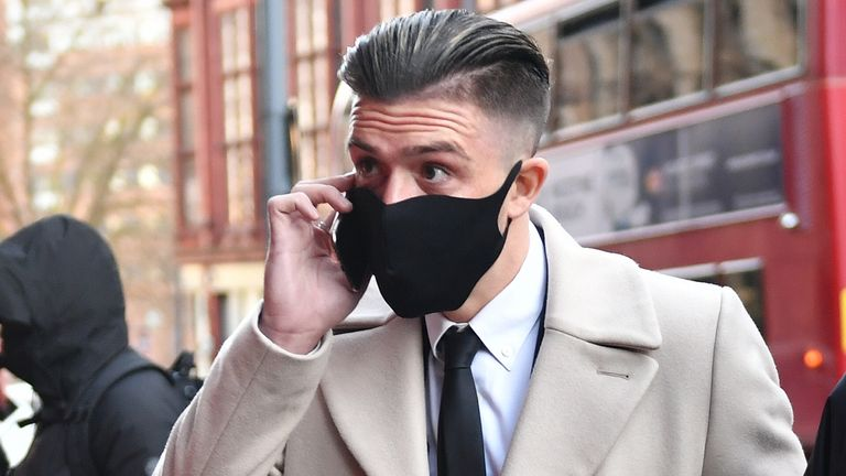 Aston Villa captain Jack Grealish (left), arrives at Birmingham Magistrates' Court, Birmingham, for sentencing after pleading guilty to two counts of driving without due care and attention.
