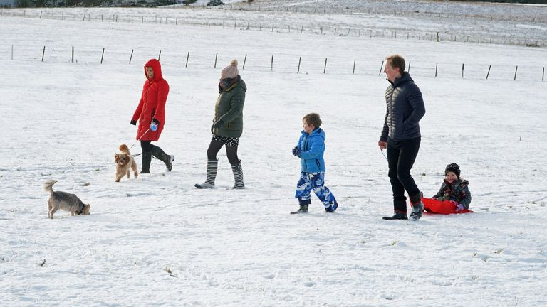 A family make the most of the snow near Hexham, Northumberland on Christmas morning
