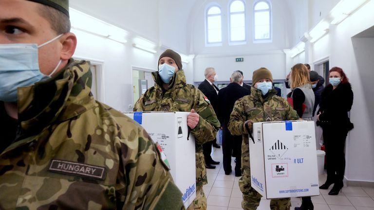 Hungarian soldiers carry the first shipment of Pfizer-BioNTech coronavirus disease (COVID-19) vaccines at the Del-Pest Central Hospital in Budapest, Hungary, December 26, 2020