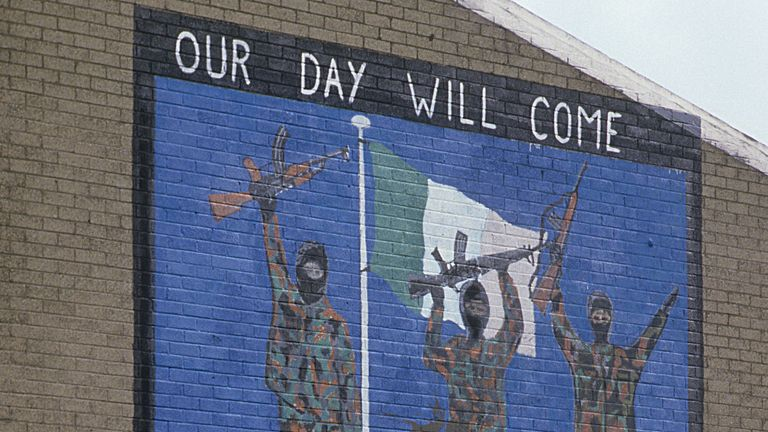 Belfast, Northern Ireland: Youth stand under a pro IRA mural in the neighborhoods of west Belfast which is the heart of Catholics with strong Republican sentiments. (Photo by Kaveh Kazemi/Getty Images)