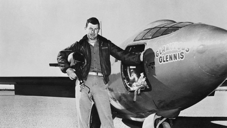 Captain Charles Yaeger besides Bell X-1 after first powered take off of supersonic plane.