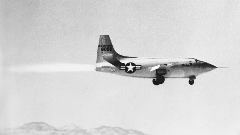 1/11/1949-Murac Lace, CA: The Bell X-1 on on first powered take off of the Supersonic plane. Picture taken shortly after take off. All four cylinders of rocket engine are in operation.
