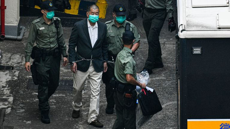 Hong Kong media tycoon Jimmy Lai is seen handcuffed and escorted by the guards leaving prison