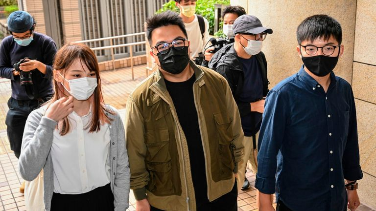 Pro-democracy activists (L-R) Agnes Chow, Ivan Lam and Joshua Wong arriving at court in November