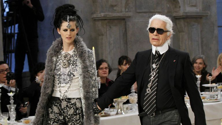 "Fashion designer Karl Lagerfeld (R) and British model Stella Tennant pictured during the Chanel Metiers d'Art Pre-Fall collection show, entitled ""Paris-Bombay"" on December 6, 2011 in Paris"