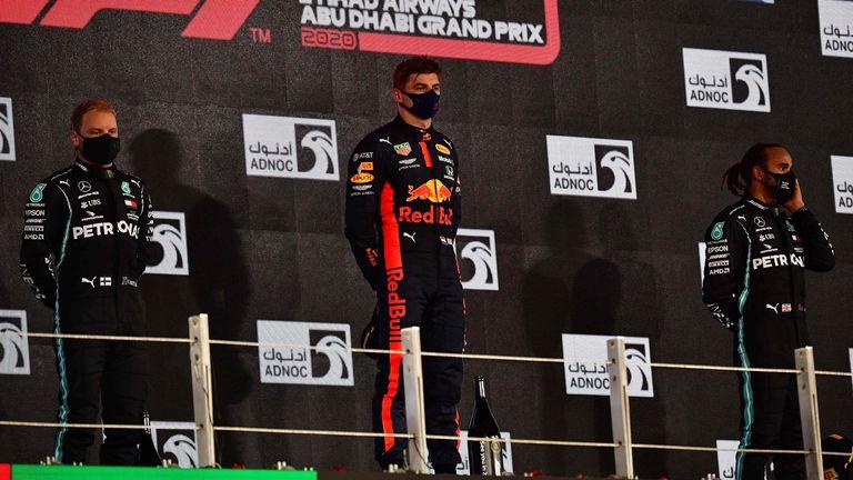 Lewis Hamilton (R) finished third at the Abu Dhabi GP - behind Max Verstappen (C) and Valtteri Bottas (L)