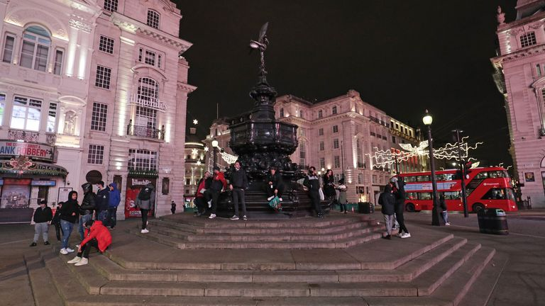 The statue of Eros in Piccadilly Circus in London, as London's New Year's Eve fireworks display has been cancelled