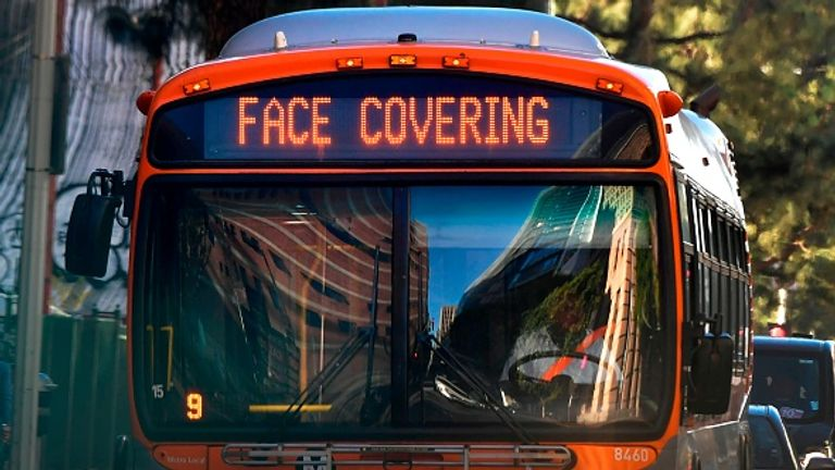 A health reminder on an LA bus as infections in the city saw a record-breaking surge