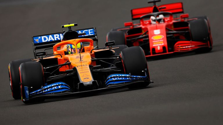 BUDAPEST, HUNGARY - JULY 18: Lando Norris of Great Britain driving the (4) McLaren F1 Team MCL35 Renault leads Sebastian Vettel of Germany driving the (5) Scuderia Ferrari SF1000 during qualifying for the F1 Grand Prix of Hungary at Hungaroring on July 18, 2020 in Budapest, Hungary. (Photo by Leonhard Foeger/Pool via Getty Images)