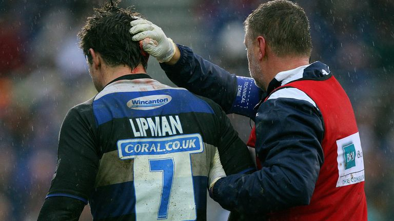 Michael Lipman gets treated for a head injury while playing for Bath in 2009