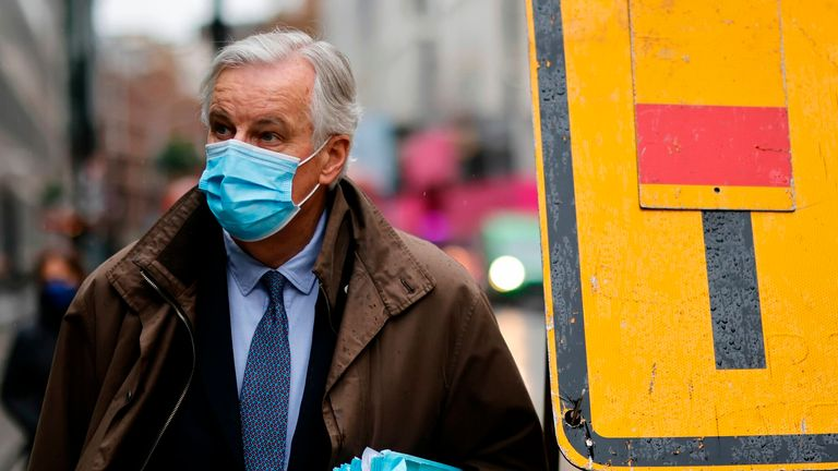 EU chief negotiator Michel Barnier, wearing a protective face covering to combat the spread of the coronavirus, walks to a conference centre in central London on December 3, 2020 as talks continue on a trade deal between the EU and the UK