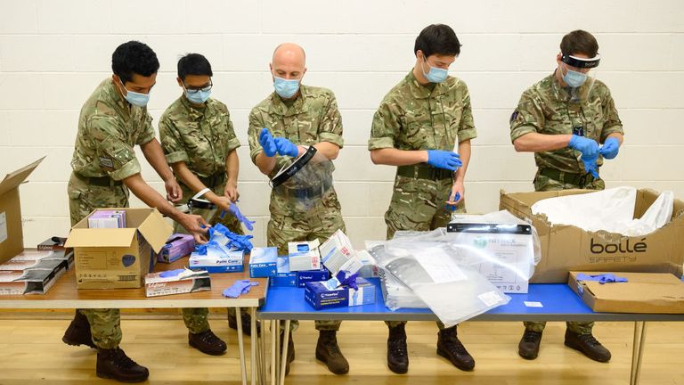 MERTHYR TYDFIL, WALES - NOVEMBER 24: RAF personnel don PPE as they prepare to shadow health workers at a temporary COVID-19 testing site within a leisure centre on November 24, 2020 in Merthyr Tydfil, Wales. The British Armed Forces have deployed around 170 RAF personnel to support mass testing in Merthyr Tydfil and surrounding areas in South Wales. The personnel are helping to run mass testing sites around the town and are using lateral flow tests to help identify asymptomatic cases and break c