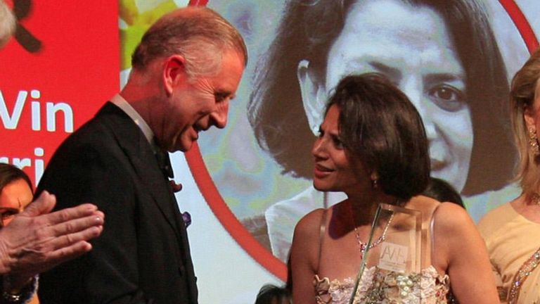 The Prince of Wales and Duchess of Cornwall give the Chairman's Award to Vin Murria as they attend the Asian Women of Achievement Awards in 2009