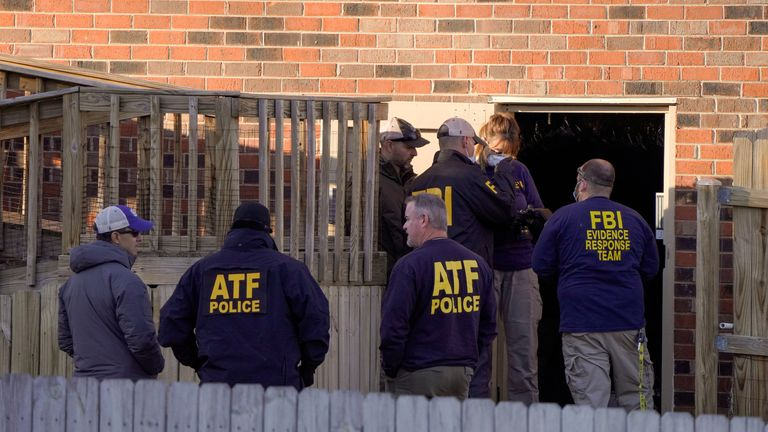 Law enforcement officers gather to investigate information arising the day after a downtown Nashville explosion, outside a duplex house in Antioch, Tennessee, U.S. December 26, 2020. REUTERS/Harrison McClary