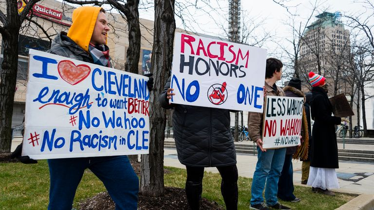 Protestors express their disapproval of the Cleveland Indians Chief Wahoo logo on April 6, 2018 in Cleveland, Ohio