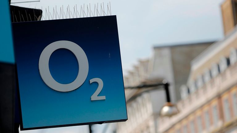 A sign is pictured outside an O2 mobile phone store