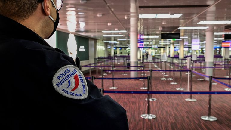 A police officer at Charles De Gaulle airport in Paris
