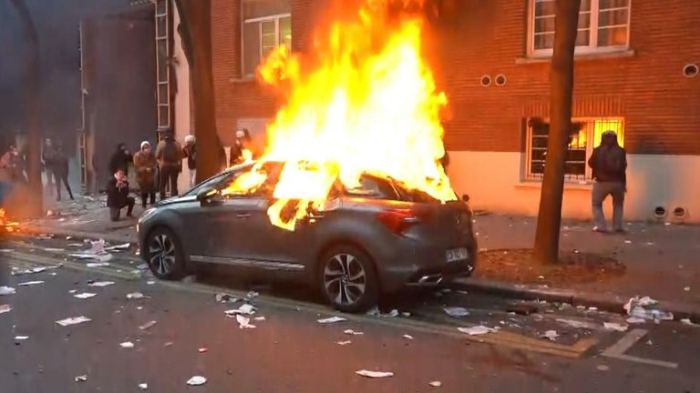 Cars have been set on fire during protests in Paris against a new security law