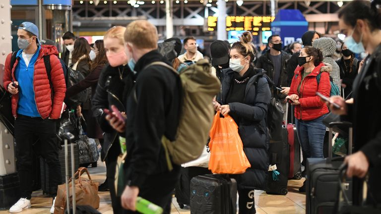 People wait on the concourse at Paddington Station in London, on the last Saturday shopping day before Christmas, after the announcement that London will move into Tier 4 Covid restrictions from midnight.