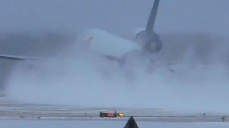 Plane disappears in snow as it lands at airport