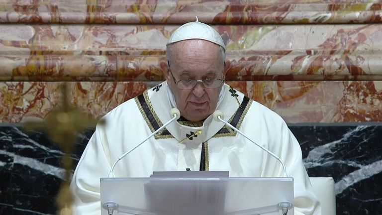 Pope Francis gives his Christmas Eve mass to a small congregation at St Peter's Basilica