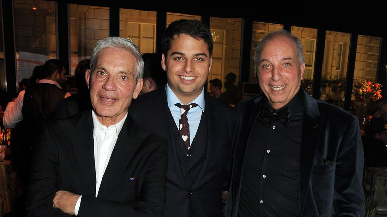 Jamie Reuben's uncle Simon (left) and his father David (right)  are reported to be worth £16bn