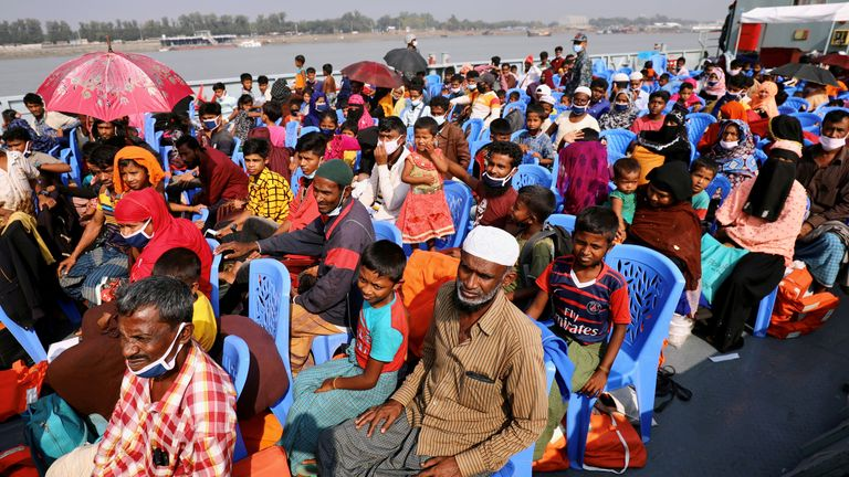 Rohingya refugees aboard a ship as they are moved to Bhasan Char island on 4 December