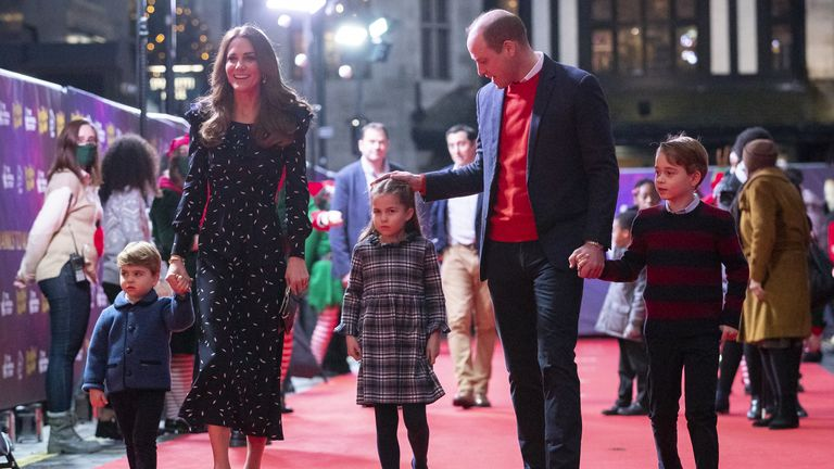 William reassures Princess Charlotte on the way in for the panto