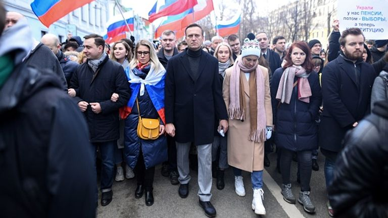 Navalny is pictured with Sobol (L) and his wife Yulia on a march in Moscow earlier this year