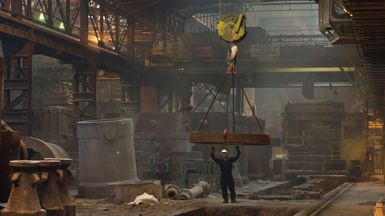 A worker sets a pit for casting a steel ingot in the Melt Shop at Sheffield Forgemasters International Ltd