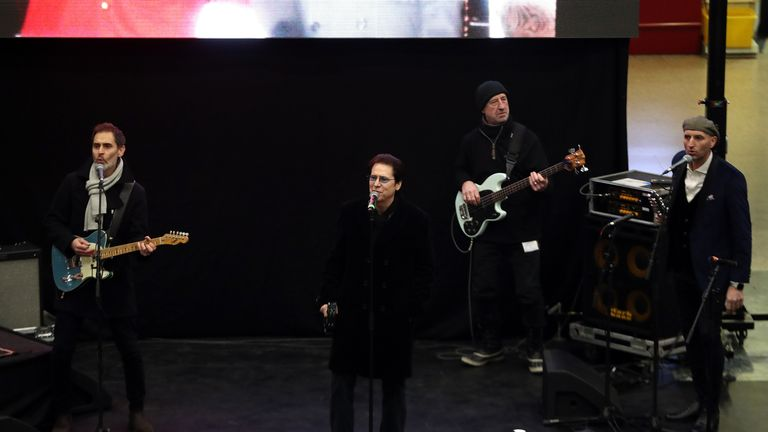 Singer Shakin' Stevens performs for the Duke and Duchess of Cambridge at London Euston Station as they prepare to board the royal train ahead of leaving London for a tour across the UK.