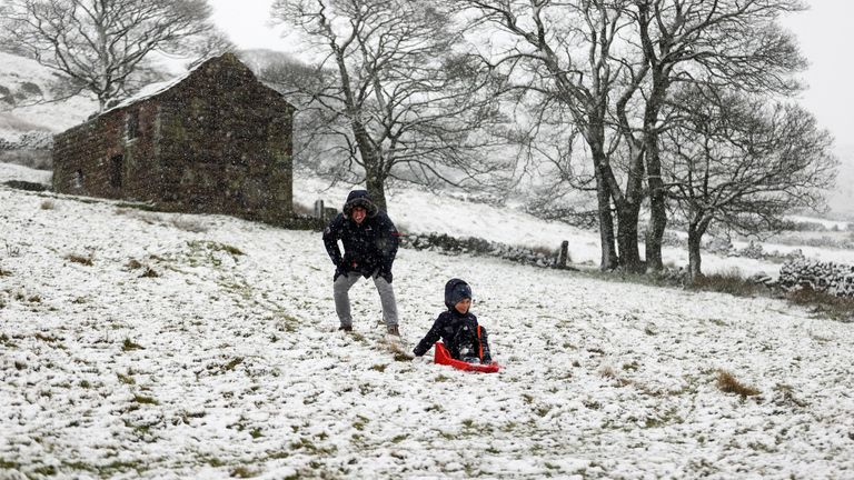 People play in the snow at The Roaches, Staffordshire