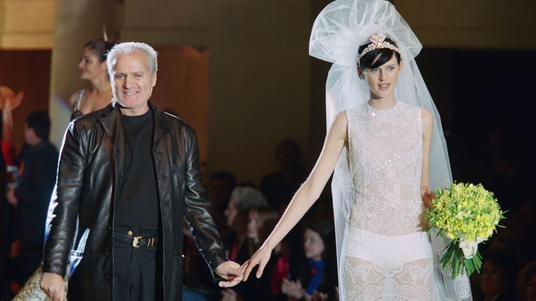 Gianni Versace with model Stella Tennant wearing a wedding dress, on January 20, 1996 in Paris