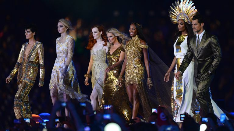 (L-R): British models Stella Tennant, Lily Cole, Karen Elson, Kate Moss, Naomi Campbell, Jourdon Dunn and David Gandy perform at the Olympic stadium during the closing ceremony of the 2012 London Olympic Games in London on August 12, 2012