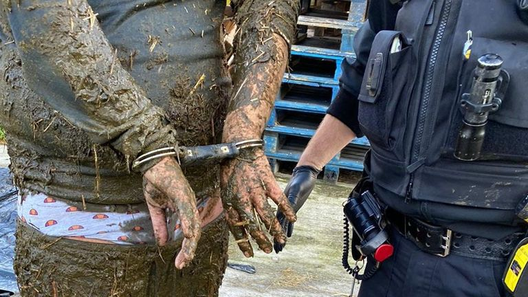 The passenger in a stolen car ended up neck-deep in a pit of slurry after a police chase. Pic: Sussex Police