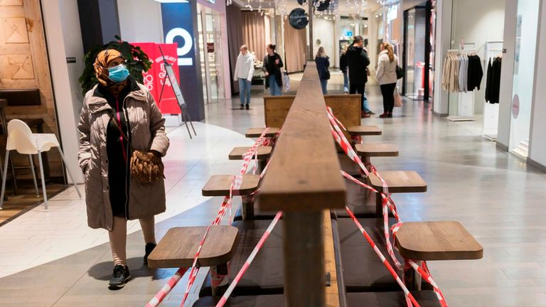 Benches are taped off at the Granbystaden shopping centre in Uppsala, Sweden