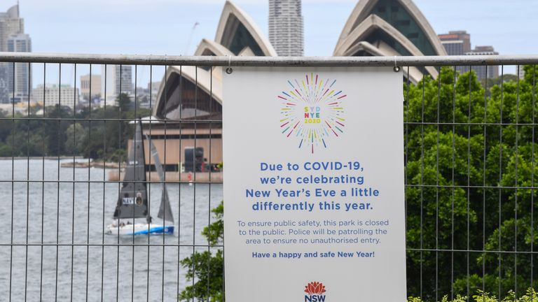 Warning signs are displayed on security fencing ahead of this year's firework display