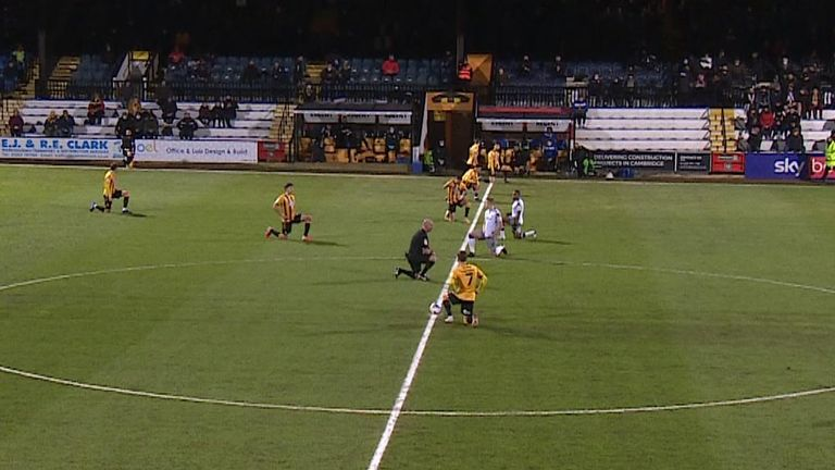 Players take a knee in Cambridge v Colchester match