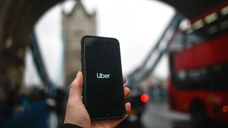 LONDON, ENGLAND - NOVEMBER 25: In this photo illustration the Uber logo is displayed on a phone in front of Tower Bridge on November 25, 2019 in London, England. Transport for London announced today, Monday, that Uber's license won't be renewed after it expires at the end of this month, November. Uber announced that they will appeal the decision. (Photo by Peter Summers/Getty Images)